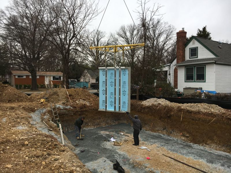 Superior Walls section lowered into position.